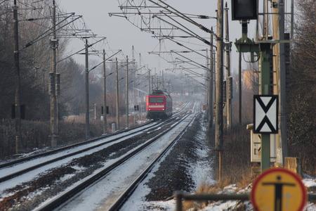 railtrack: German locomotive on snowy rails in winter.