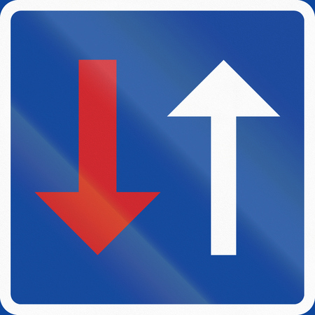 opposing: Road sign used in Sweden - Priority over oncoming vehicles.