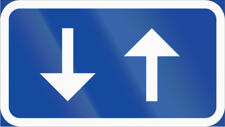 opposing: Road sign used in Sweden - Two-way traffic on cycle and moped track. Stock Photo