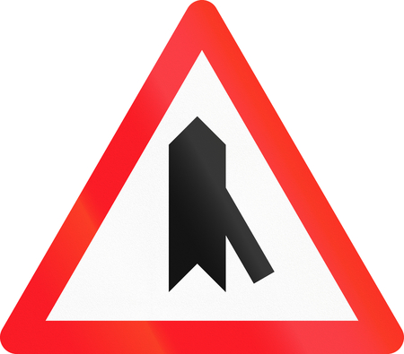 junction: Road sign used in Switzerland - Priority over junction from right.