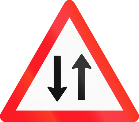 opposing: Warning sign used in Switzerland - oncoming traffic. Stock Photo
