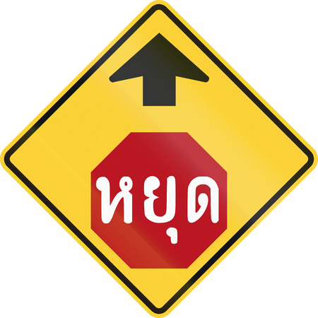 danger ahead: Warning road sign in Thailand - Stop Sign Ahead. The text means Stop.