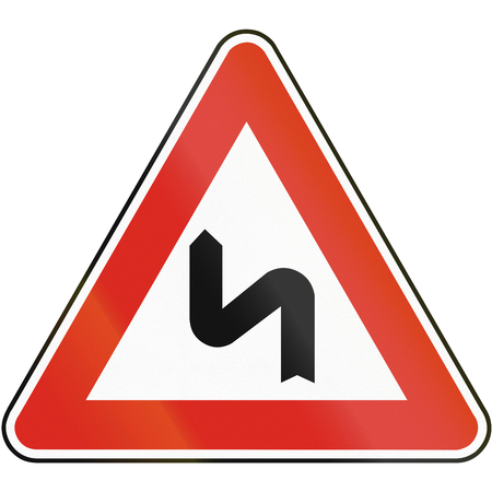 eastern europe: Road sign used in Slovakia - Double bend, first to the left. Stock Photo