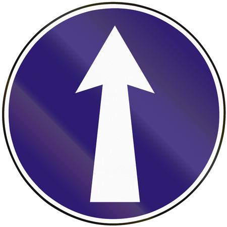 mandatory: Road sign used in Slovakia - Mandatory direction straight.