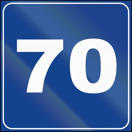 kmh: Road sign used in Italy - suggested speed of 70 kmh. Stock Photo