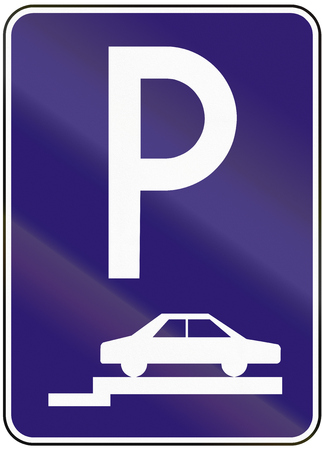 perpendicular: Road sign used in Slovakia - Parking perpendicular or diagonal on the pavement. Stock Photo