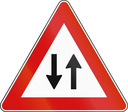 opposing: Road sign used in Italy - two-way traffic.