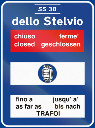 road conditions: Road sign used in Italy - Road conditions to dello Stelvio, with the words closed and as far as in different languages.