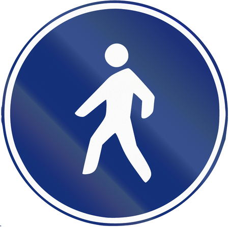 walking path: Road sign used in Spain - path reserved for pedestrians. Stock Photo