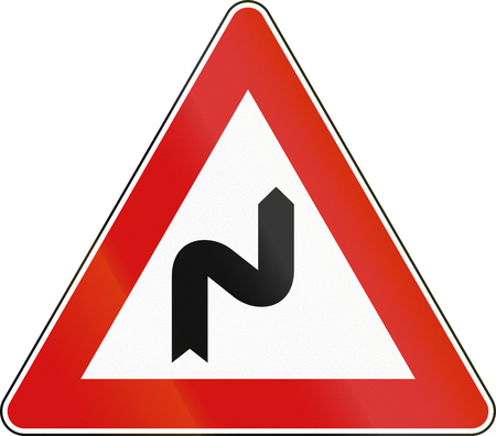 curving: Road sign used in Italy - double curved, curving first to the right. Stock Photo