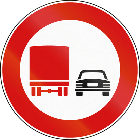 no overtaking: Road sign used in Italy - no passing by vehicles of over 3.5 tons. Stock Photo