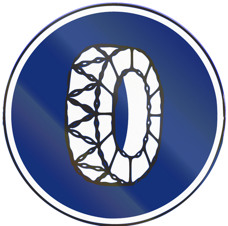 Road sign used in Spain - Snow chains mandatory.