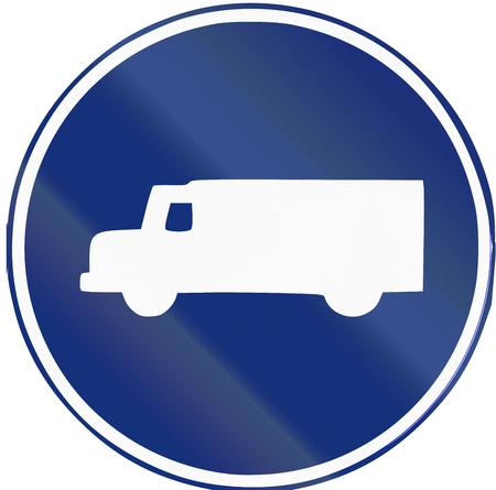 Road sign used in Spain - Mandatory Lorry lane.