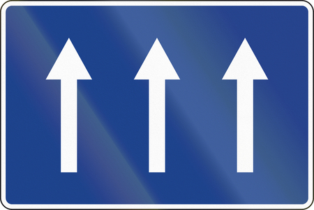 lanes: Road sign used in Spain - Three lanes one-way road.