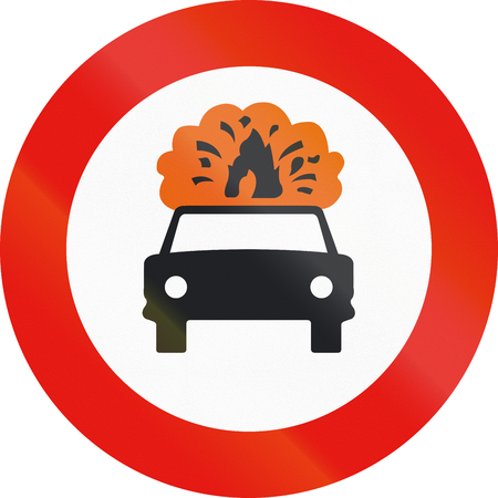 flammable: Road sign used in Spain - Forbidden entry to vehicles carrying explosive or flammable goods. Stock Photo