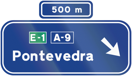 direction sign: Road sign used in Spain - Direction sign.