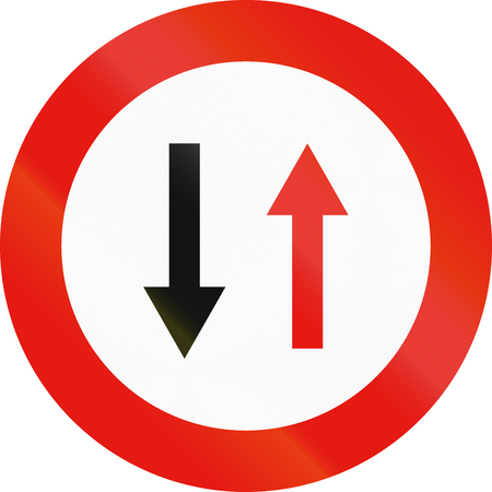 priority: Road sign used in Spain - Priority of oncoming traffic. Stock Photo