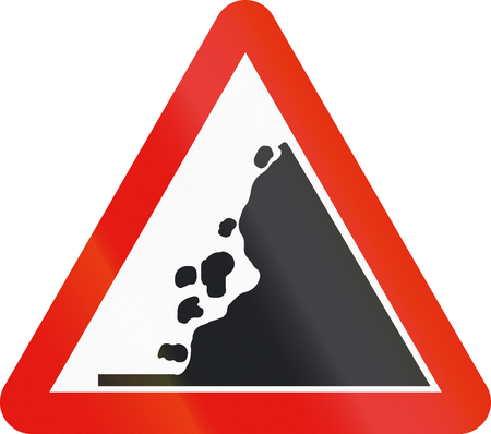 Road sign used in Spain - Falling rocks on the right. 免版税图像
