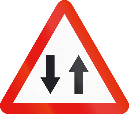 opposing: Road sign used in Spain - Traffic in both directions.