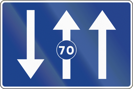 opposing: Road sign used in Spain - Lanes for traffic based on the posted speed.