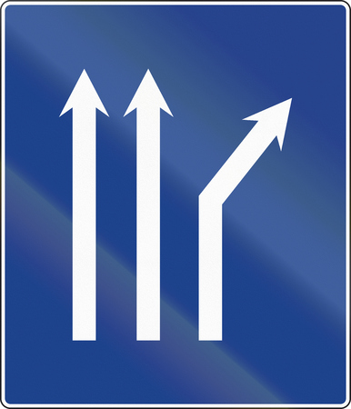 Road sign used in Spain - Fork right on three-lane carriageway.