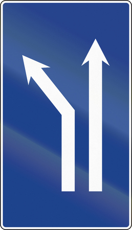 Road sign used in Spain - Fork left onto dual carriageway.