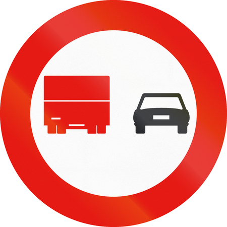 no overtaking: Road sign used in Spain - Overtaking banned for trucks.