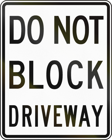 driveway: Road sign used in the US state of Delaware - Do not block driveway. Stock Photo