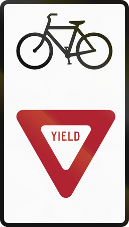 Road sign used in the US state of Delaware - Give way to bicyclists. Stock Photo