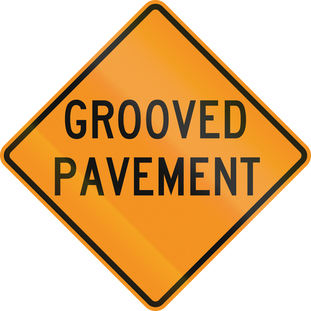 United States MUTCD road sign - Grooved pavement. Stock Photo
