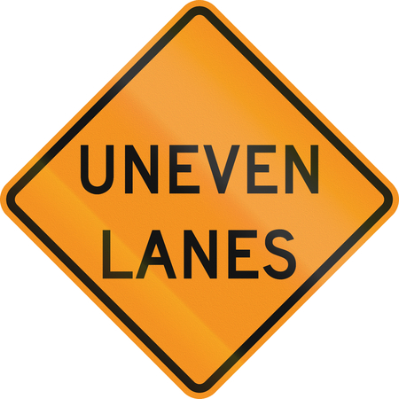 uneven: United States MUTCD road sign - Uneven lanes. Stock Photo