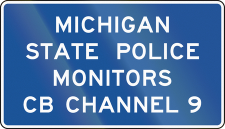 police state: United States MUTCD guide road sign - Michigan state police monitors. Stock Photo
