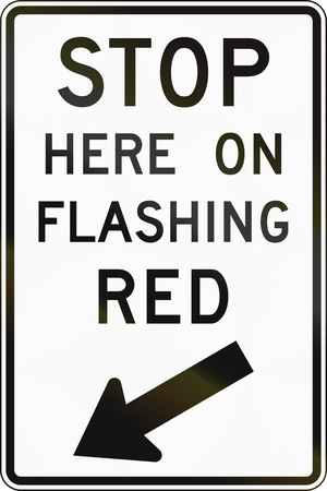 flashing: United States MUTCD road sign - Stop here on flashing red. Stock Photo
