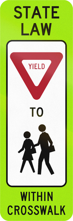 yield sign: United States MUTCD crosswalk road sign - Yield to children. Stock Photo