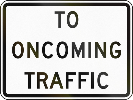 opposing: United States MUTCD road sign - To oncoming traffic. Stock Photo