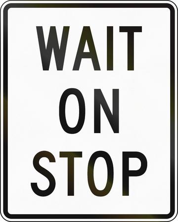 wait: United States MUTCD road sign - Wait on stop. Stock Photo
