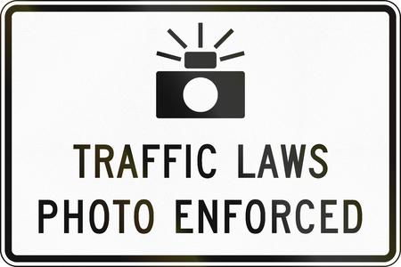 United States MUTCD road sign - Traffic laws photo enforced.