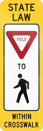 yield sign: United States MUTCD crosswalk road sign - Yield to pedestrians.