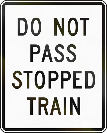 stopped: United States MUTCD road sign - Do not pass stopped train.