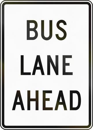 road ahead: United States MUTCD road sign - Bus lane ahead. Stock Photo