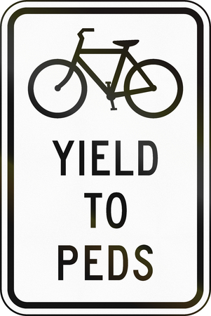 yield sign: United States MUTCD regulatory road sign - Yield to pedestrians.