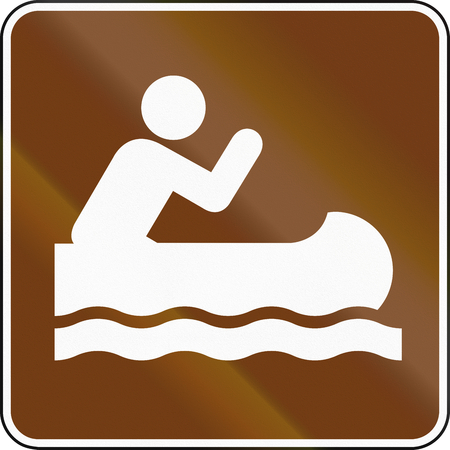 wave tourist: United States MUTCD guide road sign - Canoeing. Stock Photo