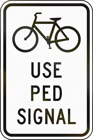 regulatory: United States MUTCD regulatory road sign - Use pedestrian signal. Stock Photo