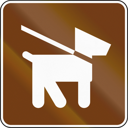 guide dog: United States MUTCD guide road sign - Dog walk area. Stock Photo