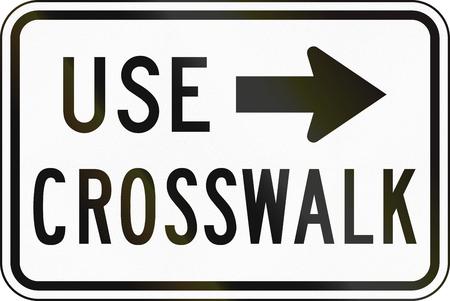 use regulation: United States MUTCD regulatory road sign - Use crosswalk. Stock Photo