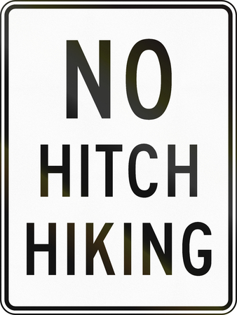 restrictions: United States MUTCD regulatory road sign - No hitchhiking. Stock Photo