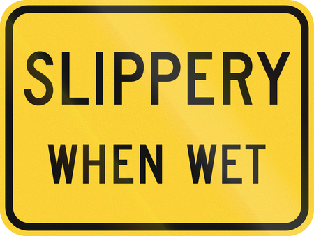 when: United States MUTCD road sign - Slippery when wet.