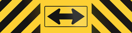 arrow sign: Road sign used in the US state of Texas - Barrier with direction.