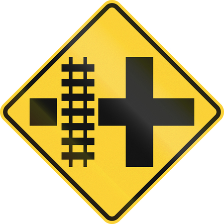 railroad crossing: United States MUTCD road sign - Level crossing and intersection. Stock Photo