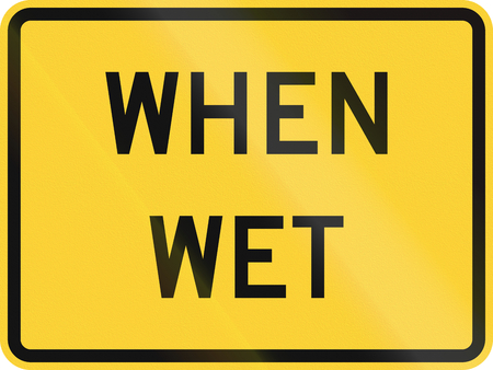 when: United States MUTCD road sign - When wet.